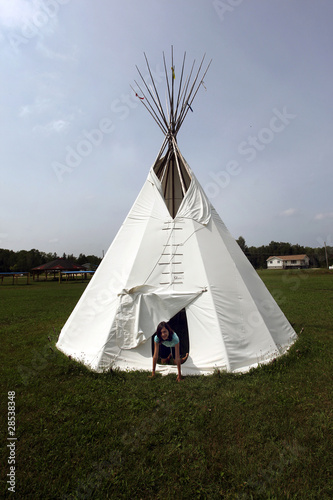 A young girl in a tepee