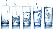 """Постер, картина, фотообои """"pouring water in a glass collection isolated"""""""
