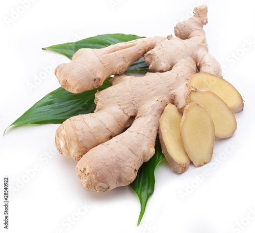 Fresh ginger with leaves isolated on white background.