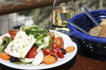 Typical taverna meal, salad, bread and white wine. Crete