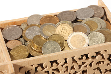 Carved wooden box filled with coins