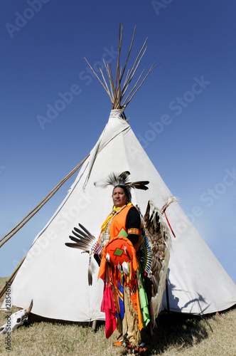Fotobehang Indiërs American Indian in Front of Tee Pee
