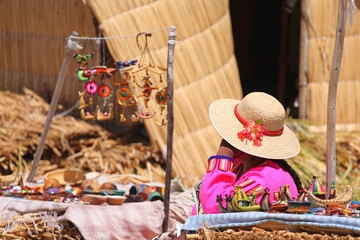 Vendor and her booth at the floating reedy island. Lake Titicaca