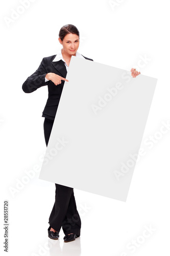 Young business woman point at white board