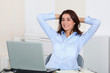 Businesswoman with stretched arms in office