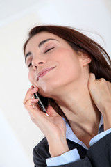 Businesswoman on the phone with relaxed expression