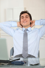 Portrait of relaxed businessman in office