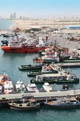 many cutters at its mooring in port. People near their cutters.