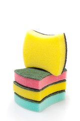 A stack of cleaning sponges on a white background