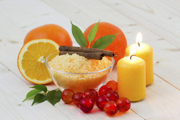 bowl of orange bath salt with fresh fruits - beauty treatment