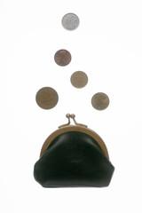 Coins fall in a purse
