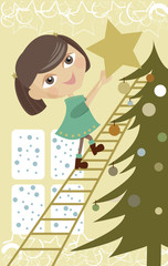 Little girl putting a star on a Christmas tree