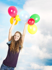 happy teen girl with balloons on sky background