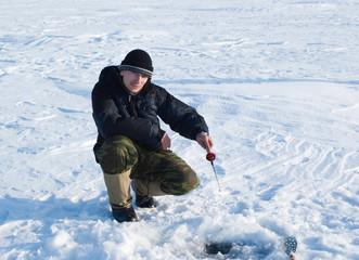 The fisherman on winter fishing