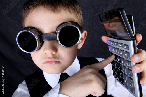 hard time in learning - boy with calculator