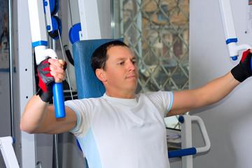Man training in fitness center