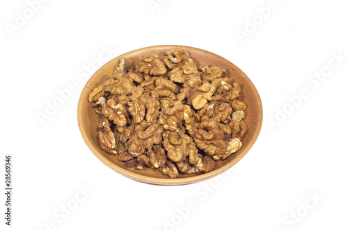 Cleared walnuts on brown plate