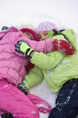 Friends Lying In The Snow