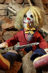 Scary doll with big knife