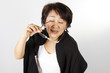 Funny woman, Asian Woman with funny face playing glasses joke.