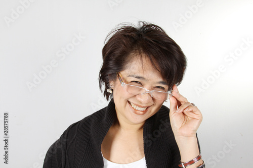 Asian Woman with natural smily face wearing glasses.