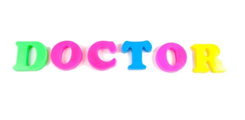 doctor written in fridge magnets on white background