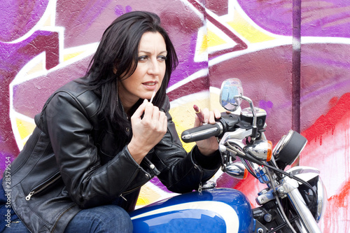 Beautiful Biker Girl Making Up