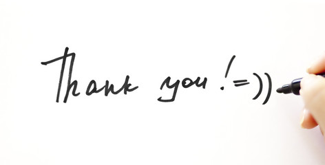 """Writing """"Thank you!"""" with smile on the white"""