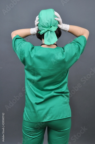 Medical doctor with headache holding her hand to the head