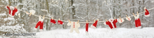 Red santa claus clothes drying