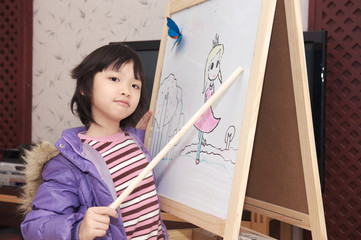 Asian kid acting as teacher