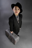 The boy in a suit of traveler