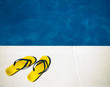 Yellow sandals  by the pool