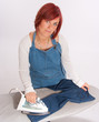 Woman ironing a childs jean