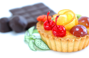 Cupcake with jelly and fruits over white