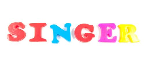 singer written in fridge magnets on white background
