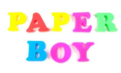 paper boy written in fridge magnets on white background