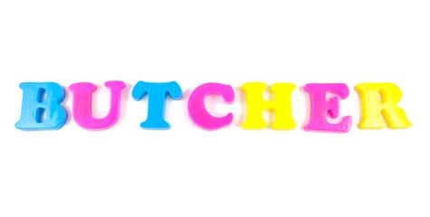 butcher written in fridge magnets on white background