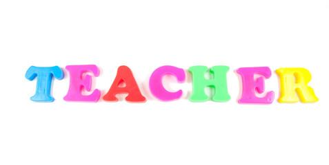 teacher written in fridge magnets on white background