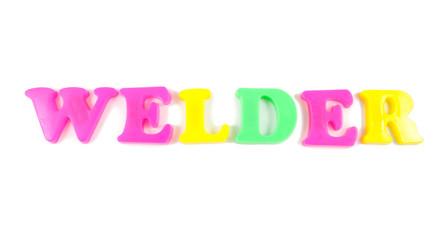 welder written in fridge magnets on white background