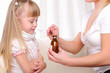 Little girl drinking cough syrup