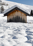 Alpin hut in the snow with hearts fissures poster