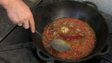 Stirring Pilaf ingredients in Wok, Chili and garlic, Closeup