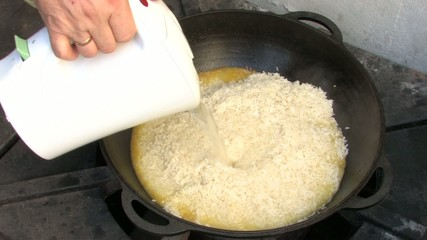 Adding Boiling Water to Pilaf ingredients in Wok