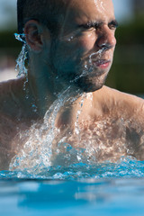 Man swimming in pool. Swim training