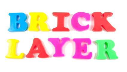 brick layer written in fridge magnets on white background