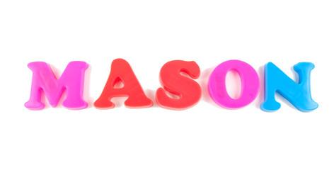 mason written in fridge magnets on white background