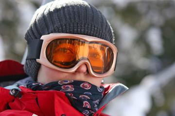 Female skier in goggles