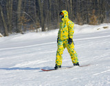 Snowboarder in a yellow suit