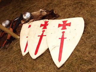 Three white shields